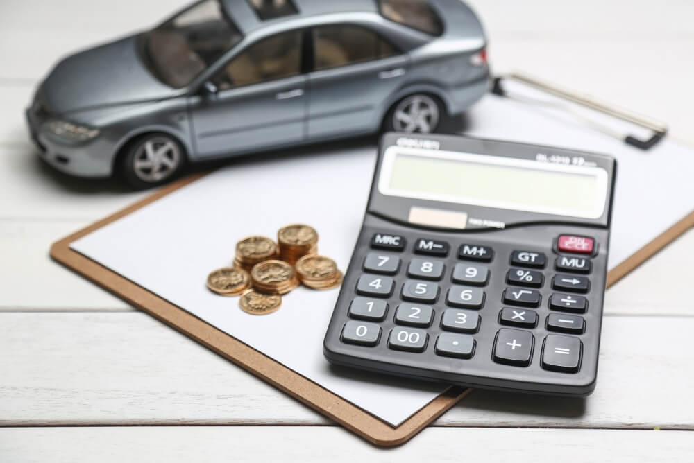 car-model-calculator-coins-white-table