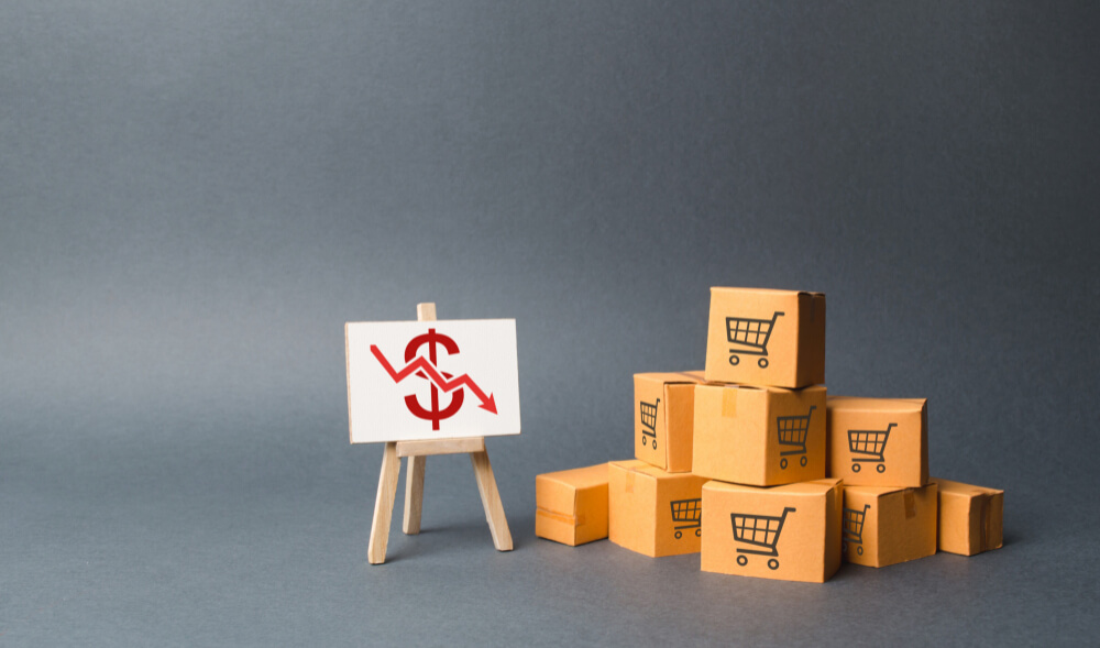 pile-cardboard-boxes-stand-with-red-down-arrow-decline-production-goods