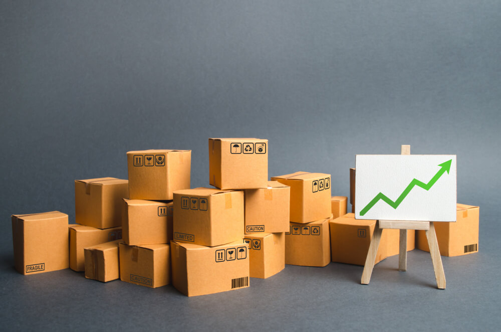 lots-cardboard-boxes-stand-with-green-up-arrow-rate-growth-production-goods