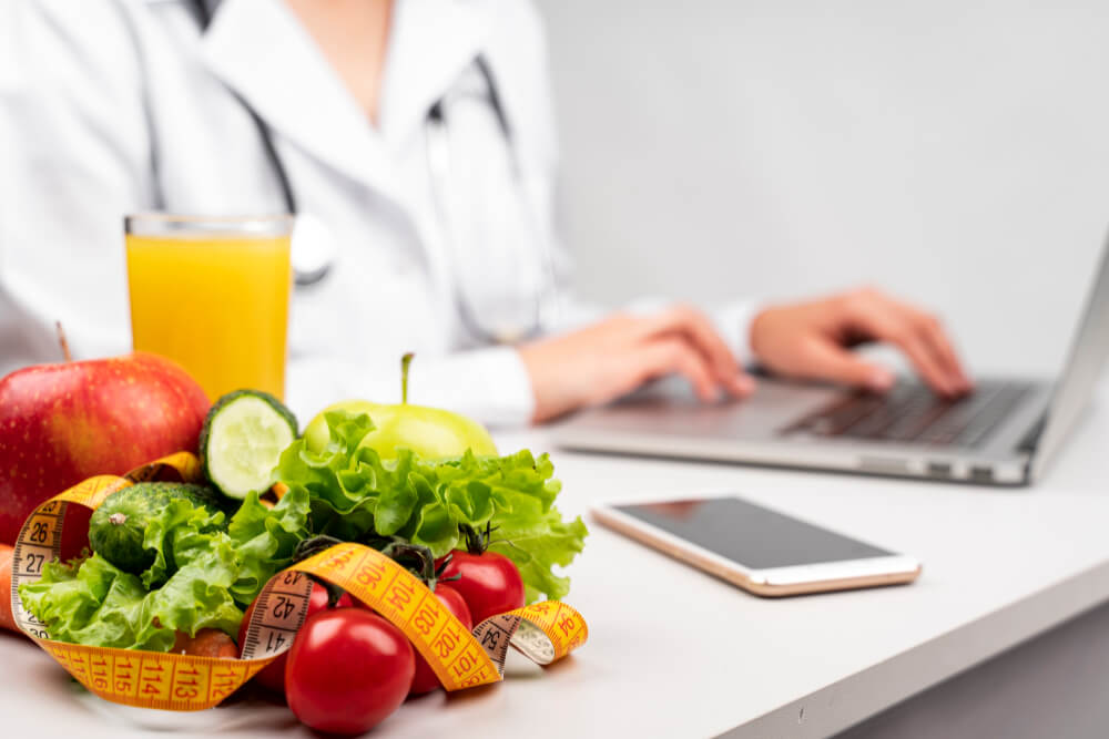 healthy-food-with-blurred-nutritionist
