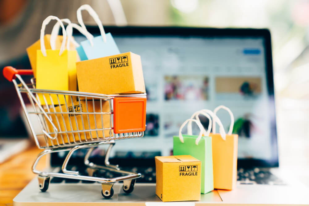 product-package-boxes-shopping-bag-cart-with-laptop-online-shopping-delivery-concept
