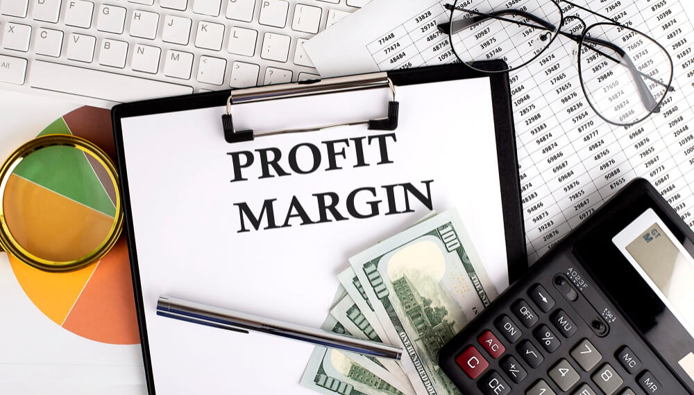 text-profit-margin-office-desk-table-with-keyboard-dollars-calculator-supplies-analysis-chart-white-surface