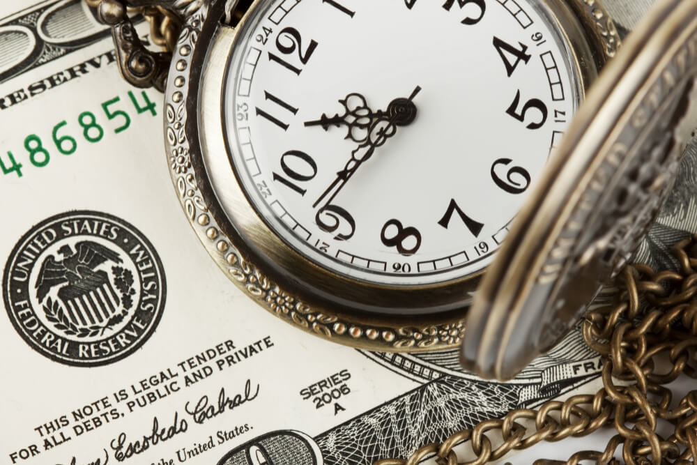 time-money-concept-image-pocket-watch-us-currency
